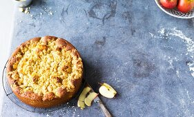 Apple cake with cinnamon crumbles and hazelnuts