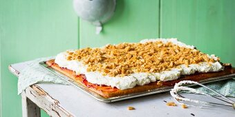 Tray bake buttermilk cake with cream and peanut brittle