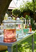 Drinks for a garden party in bottle and glass jars