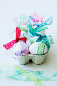 Eggs tied with colourful lace ribbons