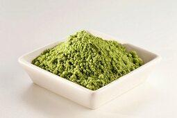 Japanese Matcha Green Tea Powder in a White Dish; White Background