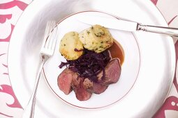 Venison medallions with red cabbage and napkin dumplings for Christmas dinner