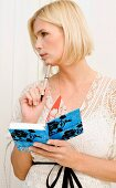 A blonde woman with a notebook