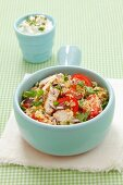 Couscous salad with grilled chicken breast, tomatoes and herbs