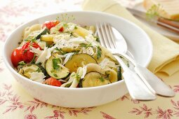 Pasta with courgettes, cherry tomatoes, herbs and Parmesan cheese