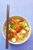 Spicy noodle soup with shrimps, chillis, courgette and coriander (Asia)
