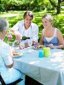 A family eating in a garden