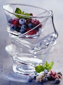 Frozen berries in stacked glass dishes