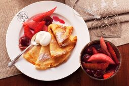 Crepes with rum fruits and cream