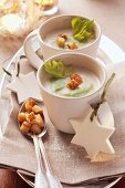 Cream of celery soup with croutons
