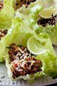Chinese roast beef on lettuce leaves