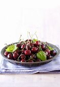 A plate of fresh cherries