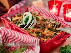 Potato bake with green cabbage and anchovies for Christmas dinner