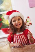 Little girl showing a gingerbread Christmas tree