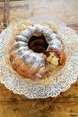 A marbled Bundt cake with icing sugar