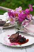 Venison with red cabbage and blackberries