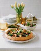 A ricotta, black olives, cherry tomatoes and basil tart