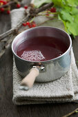 Redcurrant syrup in a pot