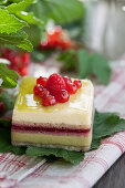 A cream slice with redcurrants