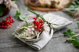 A napkin decorated with astilbe and redcurrants