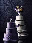 Two wedding cakes in purple and white