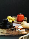 Still life with kitchen utensils, vegetables and quinces