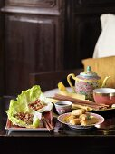 Sang choy bao (lettuce leaves with ground beef, China) spring rolls and tea