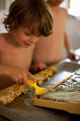 Children uncapping honey