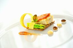 Fried turbot fillet on mushroom compote with rosemary sauce, asparagus, Comté cheese and cumin jus