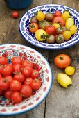 Various tomatoes in ceramic bowls