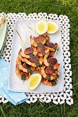 Prawn and chorizo kebabs for a picnic outside on a plate