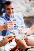 People toasting with glasses of water