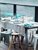A simply laid table on a veranda