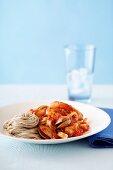 Buckwheat spaghetti with seafood and marinara sauce