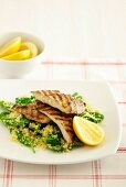 Spicy chicken on spinach couscous
