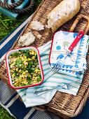 Farro sweetcorn salad and bread on a picnic basket
