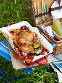 Roasted chicken with tomatoes and thyme for a picnic