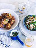 Koupes (Greek meatballs) with honey and a parsley salad