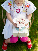 A girl holding a box of marshmallows