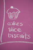 A sign advertising a cake sale