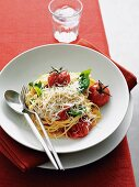 Spaghetti with oven-roasted tomatoes and grated cheese