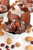 A mini chocolate cake with almonds, walnuts and cranberries