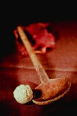 White chocolate praline and a wooden spoon