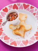 Heart-shaped crisps with a salsa dip