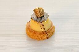 Lemon tart on a sable with a praline