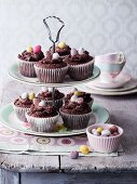 Chocolate cupcakes decorated with sugar eggs on a cake stand