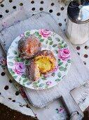 Doughnuts with vanilla cream and icing sugar