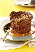 Chocolate souffle with orange sauce and orange zest