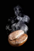 A freshly roasted coffee bean with steam