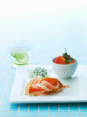 An appetizer platter with raw ham, cottage cheese and vegetables